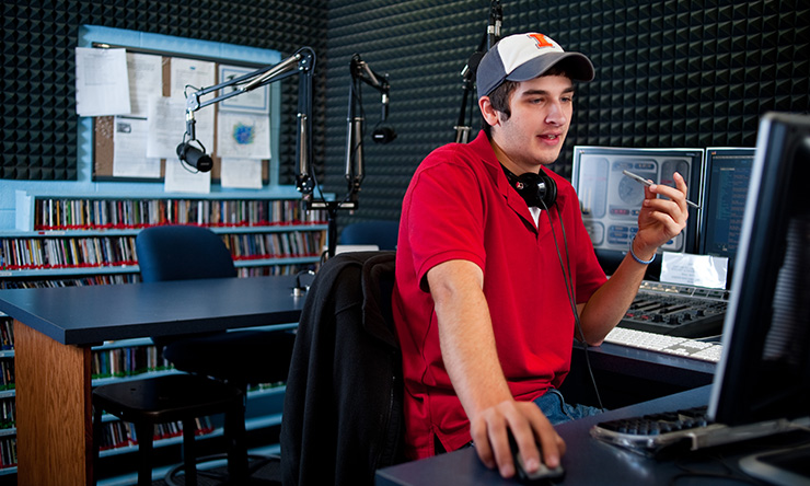 student in radio booth