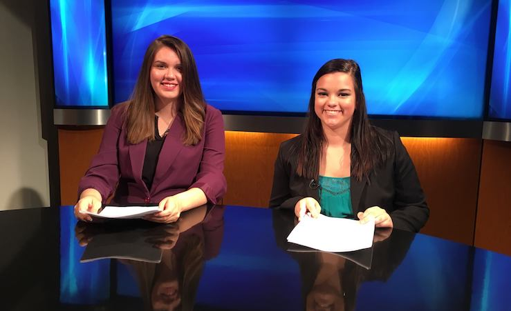 two women at anchor desk