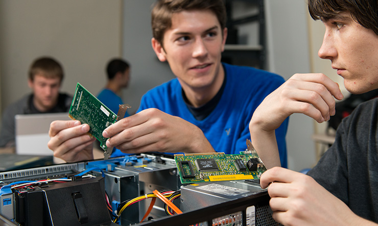 boys holding computer grids