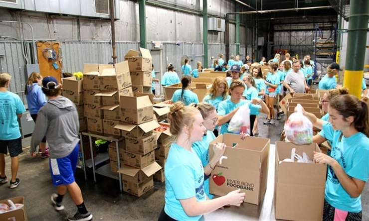 students volunteering at food bank