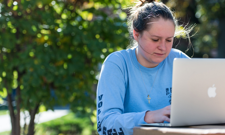 Student with Laptop outside