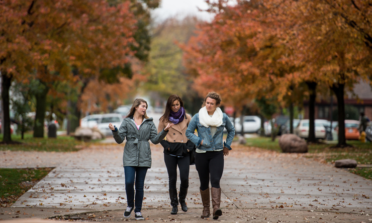three female students walking on campus