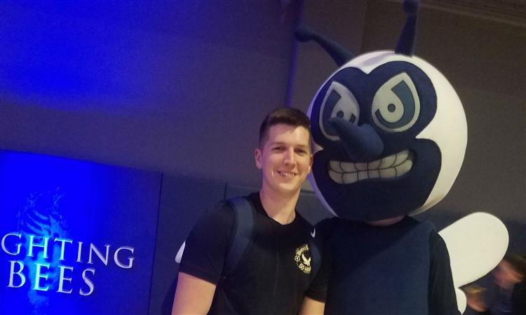 Alex Denton with Fighting Bee mascot