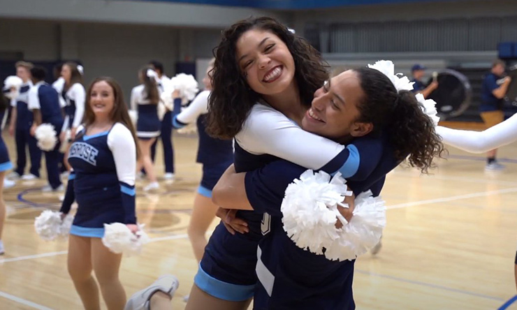 cheerleaders hugging